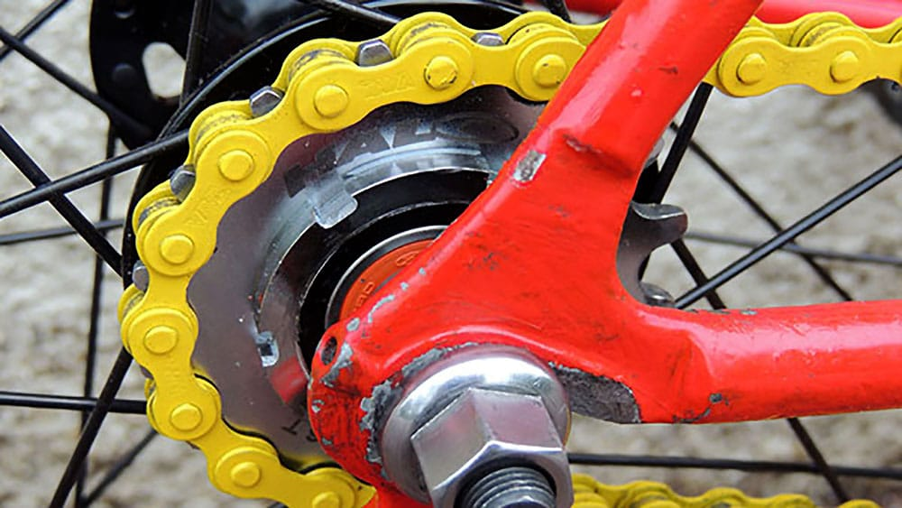 Vélo singlespeed CBT Italia jaune et rouge